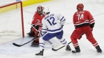 Toronto Maple Leafs' Patrick Marleau (12) scores against Carolina Hurricanes goalie Scott Darling (33) as Hurricanes' Jaccob Slavin (74) defends during the third period of an NHL hockey game in Raleigh, N.C., Friday, Nov. 24, 2017. (AP Photo/Gerry Broome)