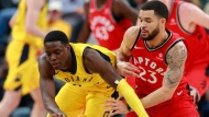 Toronto Raptors center Jonas Valanciunas, right, loses control of the basketball while attempting a shot against Indiana Pacers center Myles Turner during the first half of an NBA basketball game, Friday, Nov. 24, 2017, in Indianapolis. (AP Photo/R Brent Smith)