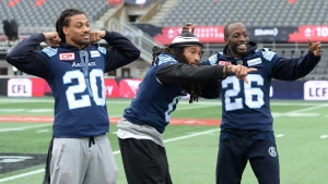 Toronto Argonauts linebacker Rico Murray, from left to right, defensive back Johnny Sears Jr. and defensive back Cassius Vaughn joke around for photographers during practice in Ottawa on Saturday, November 25, 2017.  THE CANADIAN PRESS/Nathan Denette