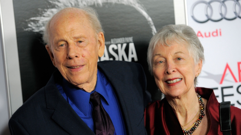 """In this Nov. 11, 2013 file photo, Rance Howard, left, a cast member in """"Nebraska,"""" and his wife Judy pose together at the 2013 AFI Fest premiere of the film at the TCL Chinese Theatre in Los Angeles. (Photo by Chris Pizzello/Invision/AP, File)"""