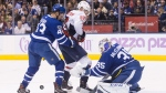 Toronto Maple Leafs goalie Curtis McElhinney (right) and Nazem Kadri combine to deny Washington Capitals' Evgeny Kuznetsov during first period NHL hockey action in Toronto, on Saturday, November 25, 2017.THE CANADIAN PRESS/Chris Young
