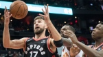 Toronto Raptors center Jonas Valanciunas (17), of Lithuania, vies for a rebound with Atlanta Hawks center Dewayne Dedmon and forward OG Anunoby (3), of England, during the second half of a NBA basketball game, Saturday, Nov. 25, 2017, in Atlanta. (AP Photo/John Amis)