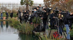 Media wait for the arrival of Britain's Prince Harry and his fiancee Meghan Markle for a photocall in the grounds of Kensington Palace in London, Monday Nov. 27, 2017. Britain's royal palace says Prince Harry and actress Meghan Markle are engaged and will marry in the spring of 2018. (AP Photo/Matt Dunham)