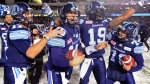 Toronto Argonauts quarterback Ricky Ray, second from left, celebrates with teammates after defeating the Calgary Stampeders in CFL football action in the 105th Grey Cup on Sunday, November 26, 2017 in Ottawa. THE CANADIAN PRESS/Paul Chiasson