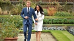 Britain's Prince Harry and Meghan Markle arrive for a media event in the grounds of Kensington Palace in London, Monday Nov. 27, 2017. It was announced Monday that Prince Harry, fifth in line for the British throne, will marry American actress Meghan Markle in the spring, confirming months of rumors. (Dominic Lipinski/PA via AP)