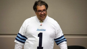 Calgary mayor Naheed Nenshi wears a Toronto Argonauts during a council meeting at city hall in Calgary on Monday, Nov. 27, 2017. THE CANADIAN PRESS/Jeff McIntosh