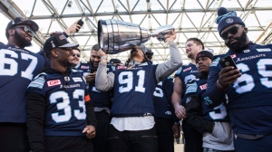 Toronto Argonauts players show off the Grey Cup to fans gathered in Toronto's Nathan Phillips Square as the team holds a rally on Tuesday, November 28 2017. Toronto celebrated their 27-24 win over Calgary Stampeders to win the 2017 Grey Cup. THE CANADIAN PRESS/Chris Young