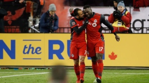 Toronto FC forward Jozy Altidore (17) celebrates his goal with midfielder Victor Vazquez (7) during second half MLS eastern conference final playoff soccer action against the Columbus Crew in Toronto on Wednesday, November 29, 2017. THE CANADIAN PRESS/Mark Blinch