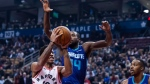 Toronto Raptors guard DeMar DeRozan (10) charges towards the net against Charlotte Hornets forward Michael Kidd-Gilchrist (14) in first half NBA basketball action in Toronto on Wednesday, November 29, 2017. THE CANADIAN PRESS/Christopher Katsarov