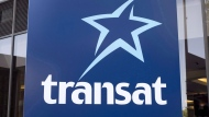 An Air Transat sign is seen Tuesday, May 31, 2016 in Montreal. THE CANADIAN PRESS/Paul Chiasson