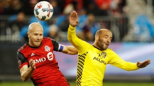 Toronto FC's Michael Bradley battles for the ball with Columbus Crew's Federico Higuain during the second half of MLS eastern conference final playoff soccer action in Toronto on Wednesday, November 29, 2017. THE CANADIAN PRESS/Mark Blinch