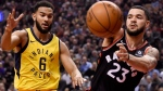 Toronto Raptors guard Fred VanVleet (23) passes the ball past Indiana Pacers guard Cory Joseph (6) during first half NBA basketball action in Toronto on Friday, December 1, 2017. THE CANADIAN PRESS/Nathan Denette