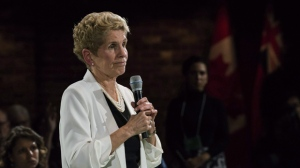Premier Kathleen Wynne addresses questions from the public during a town hall meeting in Toronto on Monday, November 20, 2017. Premier Kathleen Wynne wrapped up a trade mission to China and says the trip has secured nearly $2 billion in agreements between Ontario and Chinese companies.Speaking from Shenzhen, China on Friday, Wynne told The Canadian Press that those agreements will create more than 2,000 jobs in Ontario. THE CANADIAN PRESS/Christopher Katsarov
