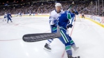 Toronto Maple Leafs' Leo Komarov, back, checks Vancouver Canucks' Troy Stecher during the first period of an NHL hockey game in Vancouver, B.C., on Saturday December 2, 2017. THE CANADIAN PRESS/Darryl Dyck