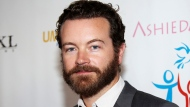 In this March 24, 2014 file photo, actor Danny Masterson arrives at the Youth for Human Rights International Celebrity Benefit in Los Angeles. (Photo by Annie I. Bang /Invision/AP, File)