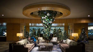 An upside down Christmas tree is seen suspended from the ceiling at the Fairmont Vancouver Airport hotel in Richmond, B.C., on Monday December 4, 2017. THE CANADIAN PRESS/Darryl Dyck