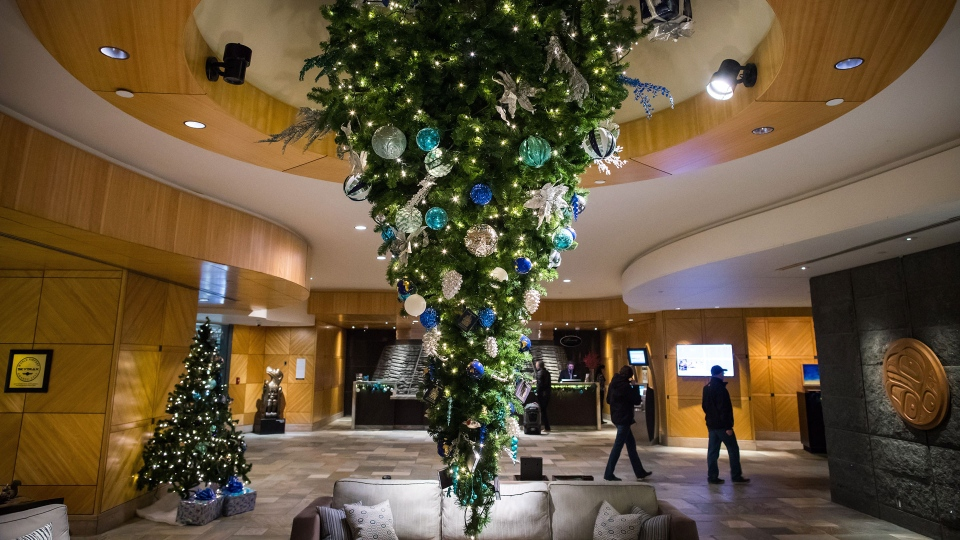 An upside down Christmas tree is seen suspended from the ceiling at the Fairmont Vancouver Airport hotel in Richmond, B.C., on Monday December 4, 2017.For those who like to up-end holiday traditions, this trend is for you: the upside down Christmas tree. THE CANADIAN PRESS/Darryl Dyck