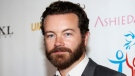 "In this March 24, 2014 file photo, actor Danny Masterson arrives at the Youth for Human Rights International Celebrity Benefit in Los Angeles. Netflix says it has written Masterson out of the comedy ""The Ranch"" with Los Angeles police investigating sexual assault claims against him that date back to the 2000s. He has denied the allegations by three women that they were assaulted by him. (Photo by Annie I. Bang /Invision/AP, File)"