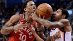 Toronto Raptors guard DeMar DeRozan (10) tries to drive to the net as Phoenix Suns guard Tyler Ulis (8) defends during second half NBA basketball action in Toronto on Tuesday, December 5, 2017. THE CANADIAN PRESS/Nathan Denette