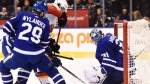 Calgary Flames centre Sean Monahan (23) tries to get the puck past Toronto Maple Leafs goalie Frederik Andersen (31) as Maple Leafs centre William Nylander (29) defends during third period NHL hockey action in Toronto on Wednesday, December 6, 2017. THE CANADIAN PRESS/Nathan Denette