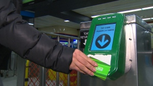 A woman taps a PRESTO fare card on a reader in a TTC station in an undated image. (CP24)