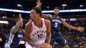 Toronto Raptors guard DeMar DeRozan (10) controls the ball against Memphis Grizzlies guards Mario Chalmers (6) and Andrew Harrison (5) in the first half of an NBA basketball game Friday, Dec. 8, 2017, in Memphis, Tenn. (AP Photo/Brandon Dill)