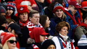 Toronto Mayor John Tory sits with fans as they wait for the start of MLS Cup Final soccer action between the Seattle Sounders and Toronto FC in Toronto on Saturday, December 9, 2017. THE CANADIAN PRESS/Mark Blinch