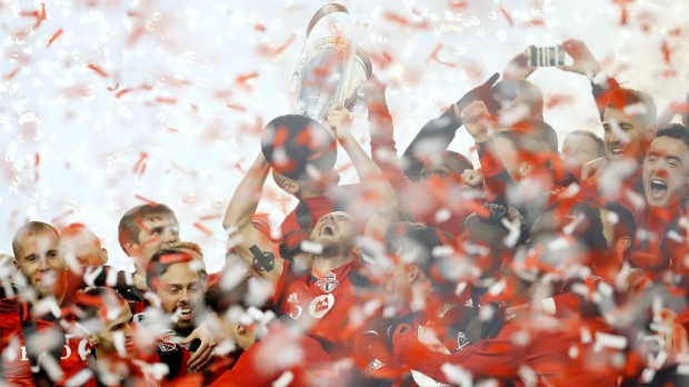 Toronto FC captain Michael Bradley hoists the trophy as the Toronto FC celebrate their win over the Seattle Sounders in the MLS Cup Final in Toronto on Saturday, December 9, 2017. THE CANADIAN PRESS/Mark Blinch