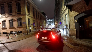 A view of a site where a synagogue was attacked in Gothenburg, Sweden, late Saturday Dec. 9, 2017. Three people was arrested for allegedly throwing firebombs at the synagogue. No one was injured in the attack during a youth event at the synagogue and the adjacent Jewish center in Sweden's second-largest city. (Adam Ihse/TT News Agency via AP)