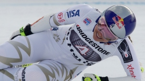 United States' Lindsey Vonn grimaces in pain after getting to the finish area of an alpine ski, women's World Cup super-G, in St. Moritz, Switzerland, Saturday, Dec. 9, 2017. (AP Photo/Giovanni Auletta)