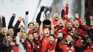 Toronto FC midfielder Michael Bradley raises the trophy as Toronto FC celebrates their victory over the Seattle Sounders in MLS Cup Final soccer action in Toronto on Saturday, December 9, 2017. THE CANADIAN PRESS/ Frank Gunn