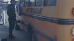 A suspect is seen filling up a school bus that Hamilton police say was stolen. (Handout /Hamilton Police)