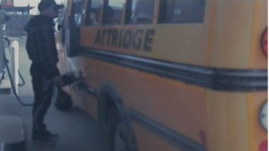 A suspect is seen filling up a school bus that Hamilton police say was stolen. (Handout /Hamilton Police)