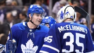 Toronto Maple Leafs centre Patrick Marleau (12) congratulates goalie Curtis McElhinney (35) on his shutout win over the Edmonton Oilers following third period NHL hockey action in Toronto on Sunday, December 10, 2017. THE CANADIAN PRESS/Frank Gunn