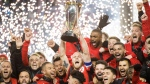 Toronto FC midfielder Michael Bradley, centre, hoists the MLS Cup with teammates after defeating the Seattle Sounders during MLS Cup soccer action in Toronto on Saturday, December 9, 2017. THE CANADIAN PRESS/Nathan Denette