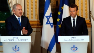 French President Emmanuel Macron, right, and Israeli Prime Minister Benjamin Netanyahu attend a press conference after a meeting at the Elysee Palace in Paris, Sunday, Dec.10, 2017. (Philippe Wojazer/Pool via AP)