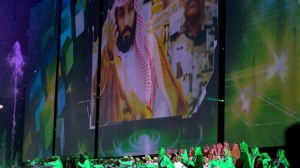 FILE - In this file photo taken on Saturday, Sept. 23, 2017 and released by Saudi Press Agency, SPA, Saudi men perform under a giant screen showing an image of Saudi Crown Prince Mohammed Bin Salman during National Day ceremonies, at the King Fahd Stadium in Riyadh, Saudi Arabia. Saudi Arabia announced on Monday, Dec. 11, 2017 it will allow movie theaters to open in the conservative kingdom next year, for the first time in more than 35 years, in the latest social push by the country's young crown prince. (Saudi Press Agency via AP, File)