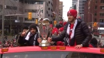 Toronto FC players carry the MLS Cup through downtown Toronto during a victory parade Monday December 11, 2017.