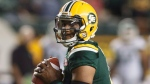 Edmonton Eskimos quarterback James Franklin (2) makes the throw against the Saskatchewan Roughriders during second half CFL action in Edmonton, Alta., on Friday August 25, 2017. THE CANADIAN PRESS/Jason Franson.