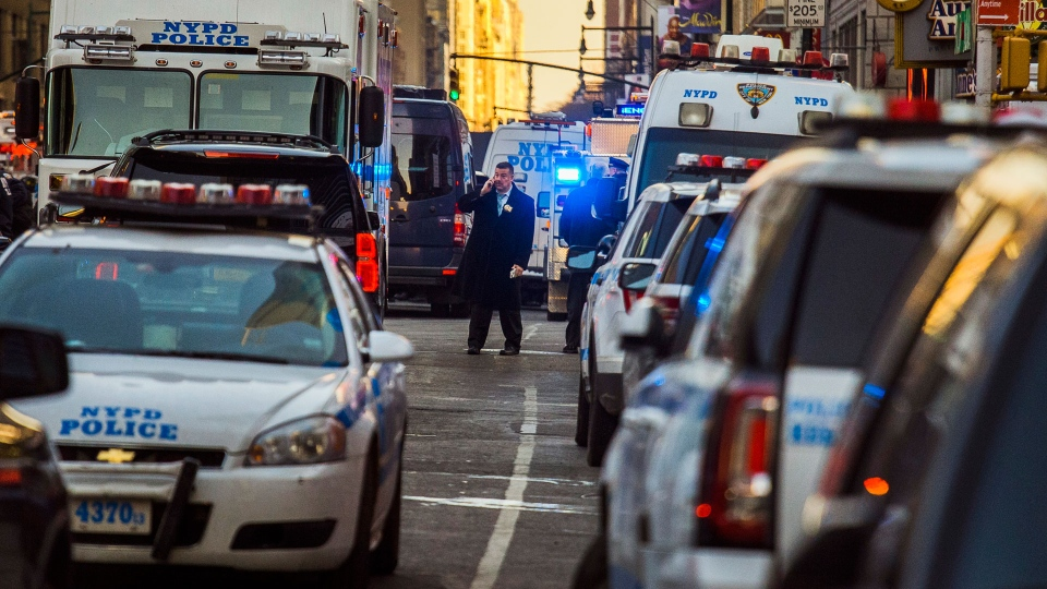 Police block a street by Port Authority Bus Terminal near New York's Times Square following an explosion on Monday, Dec. 11, 2017. (AP Photo/Andres Kudacki)