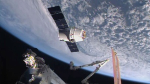 In this April 17, 2015, file image from NASA-TV, the SpaceX Dragon 6 resupply capsule nears the International Space Station. The capsule will be making a return trip to the space station when it is launched on a recycled rocket for NASA on Tuesday, Dec. 12, 2017. (NASA-TV via AP, File)