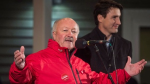 Churence Rogers, left, Liberal candidate for Bonavista-Burin-Trinity, speaks to supporters with Prime Minister Justin Trudeau in Clarenville, N.L. on Thursday, November 23, 2017. THE CANADIAN PRESS/Darren Calabrese