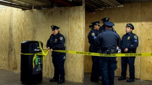 Police stand block the access to a subway tunnel next to Port Authority Bus Terminal following an explosion near Times Square on Monday, Dec. 11, 2017, in New York. Police said a man with a pipe bomb strapped to his body set off the crude device in a passageway under 42nd Street between Seventh and Eighth Avenues. (AP Photo/Andres Kudacki)