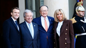 French President Emmanuel Macron, left, poses with United Nations Secretary General Antonio Guterres, second left, World Bank President Jim Yong Kim and Brigitte Macron pose at the Elysee Palace, in Paris, Tuesday, Dec. 12, 2017. More than 50 world leaders are gathering in Paris for a summit that Macron hopes will give new momentum to the fight against global warming, despite U.S. President Donald Trump's rejection of the Paris climate accord. (AP Photo/Francois Mori)