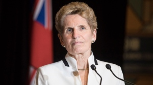 Ontario Premier Kathleen Wynne turns away from the podium in this file photo. THE CANADIAN PRESS/Chris Young