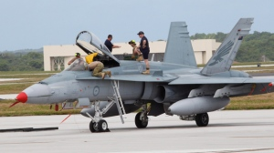 An Australian fighter jet is readied for a training mission at the Cope North military exercises at Andersen Air Force Base on the U.S. island of Guam, Thursday, Feb. 7, 2013. (AP Photo/Eric Talmadge)
