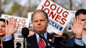 Democratic candidate for U.S. Senate Doug Jones speaks to reporters after voting Tuesday, Dec. 12, 2017, in Mountain Brook, Ala. Jones is facing Republican Roy Moore. (AP Photo/John Bazemore)