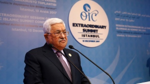 "Palestinian President Mahmoud Abbas addresses the Organisation of Islamic Cooperation's Extraordinary Summit in Istanbul, Wednesday, Dec. 13, 2017. Abbas said the Palestinians won't accept any role for the United States in a peace process with Israel ""from now on"" after the U.S President Donald Trump administration's decision to recognise Jerusalem as the capital of the Jewish state. Abbas said Trump's decision was a ""crime"" that threatens world peace. (Kayhan Ozer/Pool Photo via AP)"