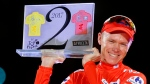 FILE - In this Sunday, Sept. 10, 2017, file photo, Britain's Chris Froome celebrates on podium after winning the Spanish Vuelta cycling race, in Madrid. Froome has been required by cycling's governing body to provide information after he returned an abnormal doping test at the Vuelta. Froome's Team Sky said In a statement that Froome has been informed by the UCI that a urine test on Sept. 7 revealed a concentration of salbutamol of 2,000 nanograms, twice the threshold of 1,000. (AP Photo/Francisco Seco, File)