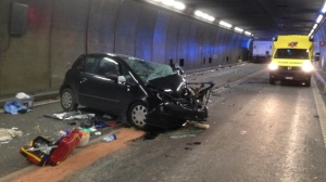 In this photo provided by the Cantonal police Uri the accident site is pictured after a collision between a car and a truck in the Gotthard tunnel near the village of Hospental, Switzerland, Wednesday, Dec. 13, 2017. Two people where killed and four injured. (Cantonal Police Uri/Keystone via AP)